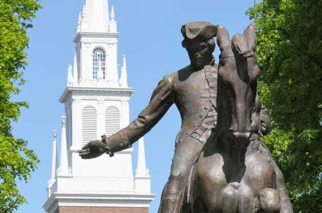 Paul Revere statue with Old North Church steeple in the background